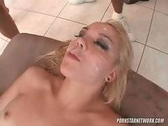 Attractive white slutie gets all her face covered in fresh cum.